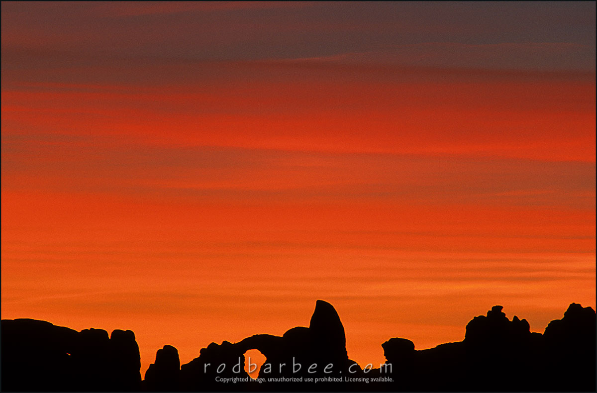 Barbee_12342_4x6 |  The Windows, silhouetted at sunrise