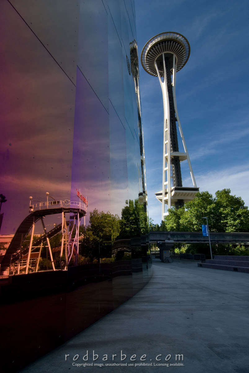 Barbee_060629_2_1364 |  Space Needle and its reflection on the wall of The Experience Music Project