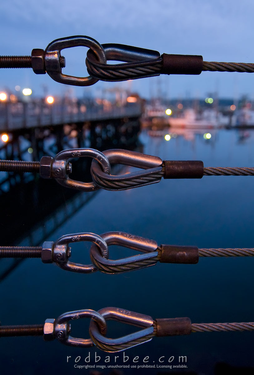 Barbee_0829_3_8042 |  Looking through cable fence at Newport harbor at twilight