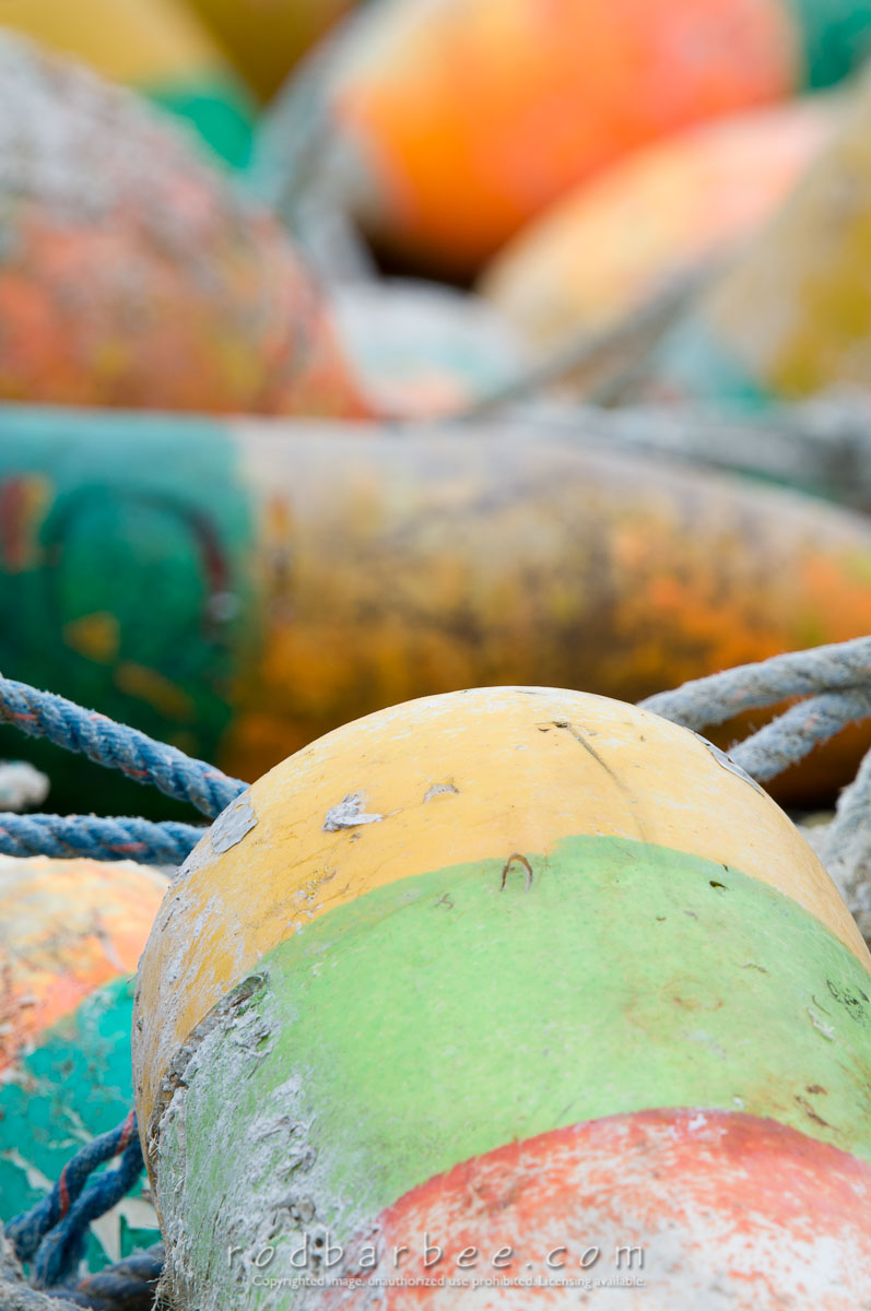 Barbee_110918_3_3941 |  Fishing Buoys piled in the dock area of Yaguina Bay Harbor in Newport, OR