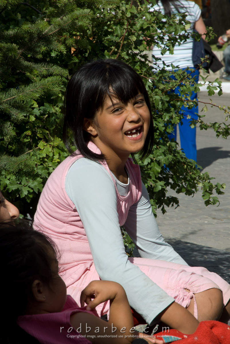 Barbee_080215_2_4472 |  Young girl having her portrait drawn during a street fair in El Calafate