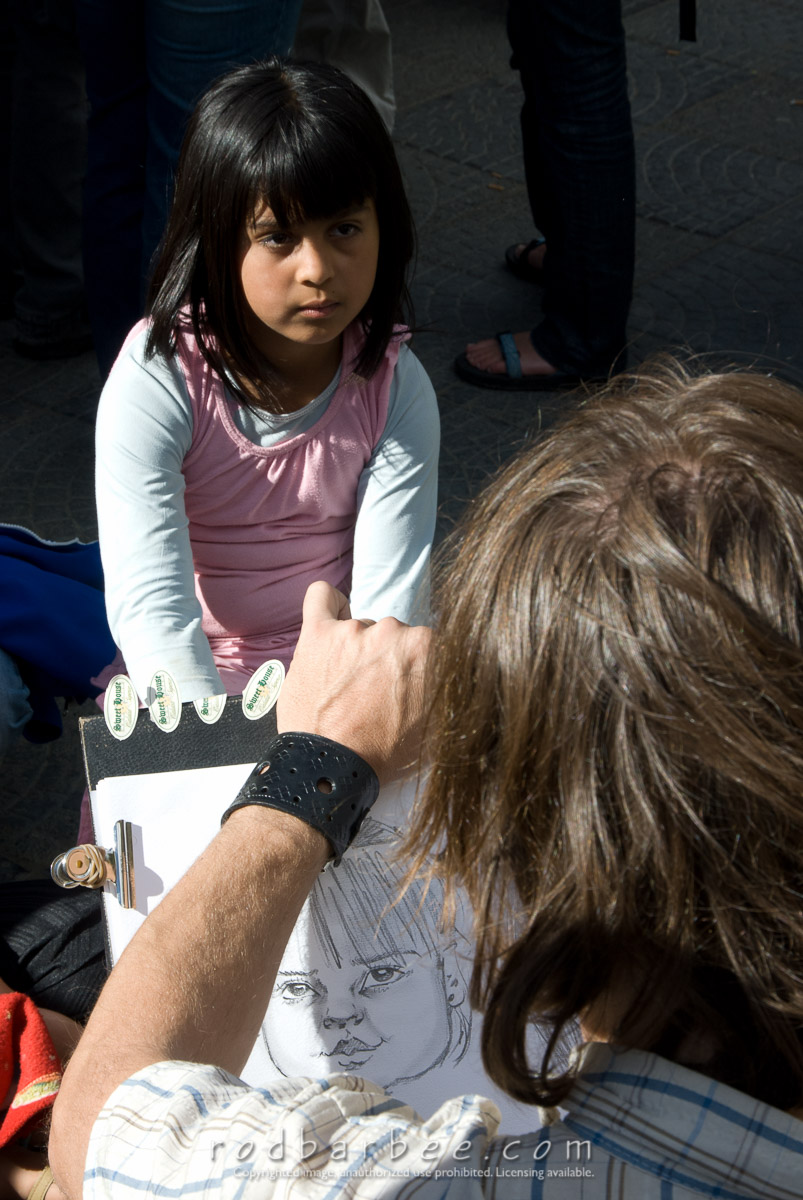 Barbee_080215_2_4482 |  Young girl having her portrait drawn during a street fair in El Calafate